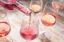 Rose Wine Poured Into A Glass, A Wine Tasting Or A Party