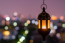 Hanging Lantern With Night Sky And City Bokeh Light Background For The Muslim Feast Of The Holy Month Of Ramadan Kareem.