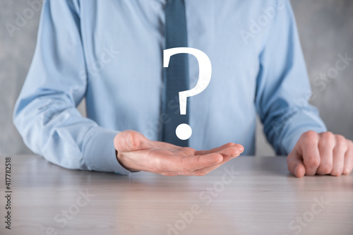 Canvas Print Businessman man hand hold interface question marks sign web