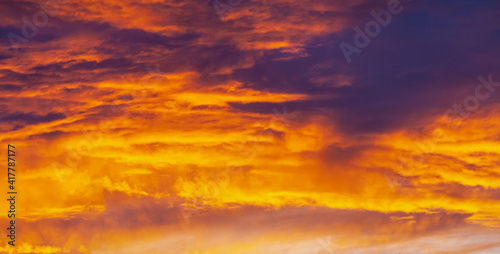 Fototapety, obrazy: Purple and orange sunset with clouds