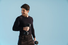 Smiling Athletic Sportsman Working Out With Dumbbells