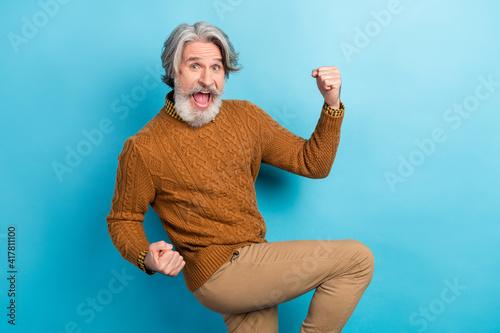Obraz Photo portrait of elder businessman happy crazy positive won lottery isolated vibrant blue color background - fototapety do salonu