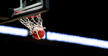 The Orange Basketball Ball Flies Through The Basket. Sports Background For Product Display, Banner, Or Mockup.