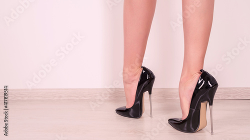 Fotografie, Tablou Woman legs in black fetish shiny patent leather stiletto high heels with ankle s
