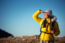 Happy Female Mountaineer Sightseeing In Nature