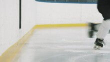 Low-section Slowmo Closeup Of Five Unrecognizable Hockey Players Going Out On Indoor Ice Arena One By One