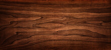 Walnut Tree Texture Close Up. Wide Walnut Wood Texture Background. Walnut Veneer Is Used In Luxury Finishes.