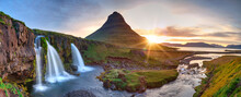 Summer Sunset On Famous Kirkjufellsfoss Waterfall And Kirkjufell Mountain. Colorful Evening Panorama Of Snaefellsnes Peninsula, Iceland, Europe.