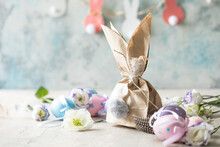 Pom Pom Easter Bunny Craft. Easter Bunny Decoration Paper Gift. DIY Holiday Garland Of Colorful Rabbits