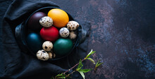 Vintage Iron Tray Full Of Colorful Easter Eggs With Hay And Spring Branch On A Dark Rustic Background. Copy Space.