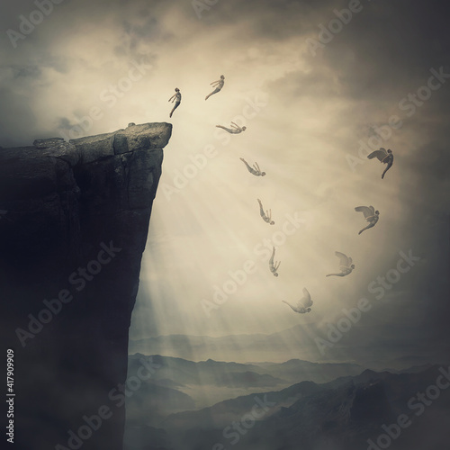 Surreal scene, determined man jumping off a cliff, fighting his fears, being confident the wings will unfold in flight Fotobehang