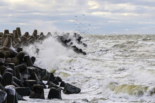 Storm On The Baltic Coast, Waves Hitting The Breakwater Concrete Tetrapods