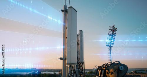 Modern antenna transmitting data at sunset Fototapet