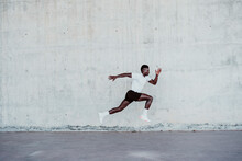 Determinant Sportsman Jumping By Wall
