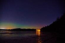 Northern Lights Over The Frozen Lake In Littoinen, Finland.