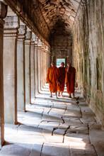 Three Monks Walking In A Corridor, Angkor, Cambodia