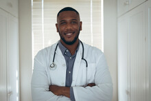 Portrait Of African American Male Doctor Looking At The Camera And Smiling