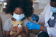 African American Male Doctor Vaccinating His Child Patient