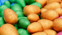 Multicolored, Foil Wrapped Easter Egg Background. Beautiful Easter Wallpaper With Vibrant Blue, Orange And Green Eggs. 3D Render