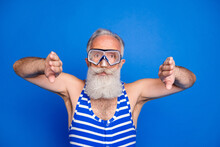Photo Of Charming Funky Elderly Man Diving Wear Goggles Swim Wear Bathing Costume Isolated On Blue Color Background