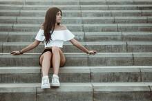 Teenage Girl Sitting On Steps, Spain