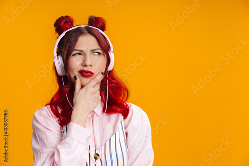 Obraz Displeased redhaired girl looking aside isolated - fototapety do salonu