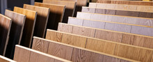 Laminate Flooring Samples In Interior Design Shop. Banner Copy Space