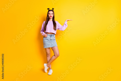 Full size photo of optimistic pretty brunette girl hold empty space wear pink sw Wallpaper Mural