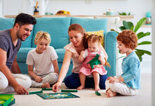 Cheerful Family Having Fun, Spending Time Together By Playing Board Games At Home