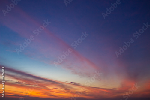 Fototapeta Dusk sky on twilight in the evening with colorful sunlight cloud on dark blue sky background obraz