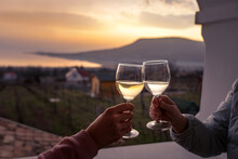 Toast With Wine Glasses At Lake Balaton With The Badacsony Hill In The Background