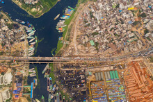 Aerial View Of A Group Of Ferry Boat Under Construction In A Shipyard Docked Along Buriganga River, Dhaka, Bangladesh.
