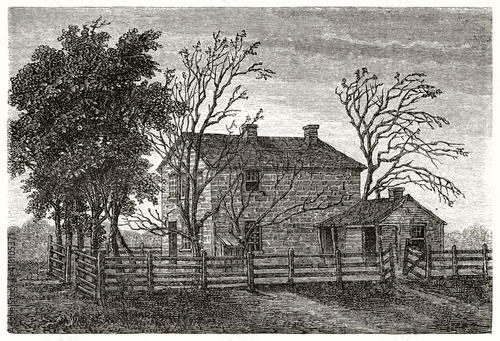 Slika na platnu isolated sad prison surrounded by wooden fence in Carthage, Illinois, where Mormon prophet Smith died