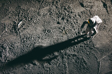 High Angle Shot Of An Astronaut Miniature Toy On The Moon