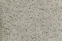 Decor Made Of Small Black And White Granite Chips On The Facade Of A House Or A Fence. Background For The Design Of Exterior Walls.