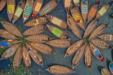 Aerial View Of Traditional Fishing Boats In Different Colours Docked At Telghat Boat Terminal In Keraniganj Along Buriganga River, Dhaka, Bangladesh.