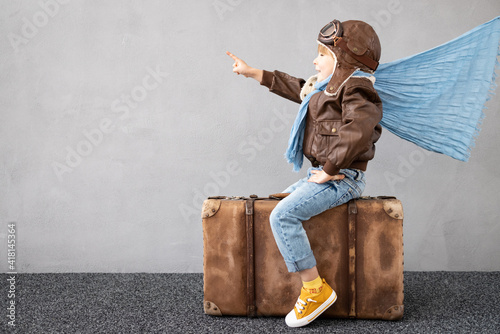 Happy child dreaming about summer vacation and travel Wallpaper Mural
