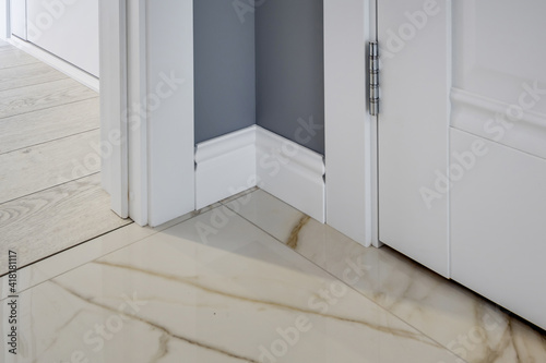 Photo Detail of corner flooring with intricate crown molding and plinth