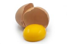 Broken Egg Isolated On White Background. Yellow Yolk And Cracked Eggshell