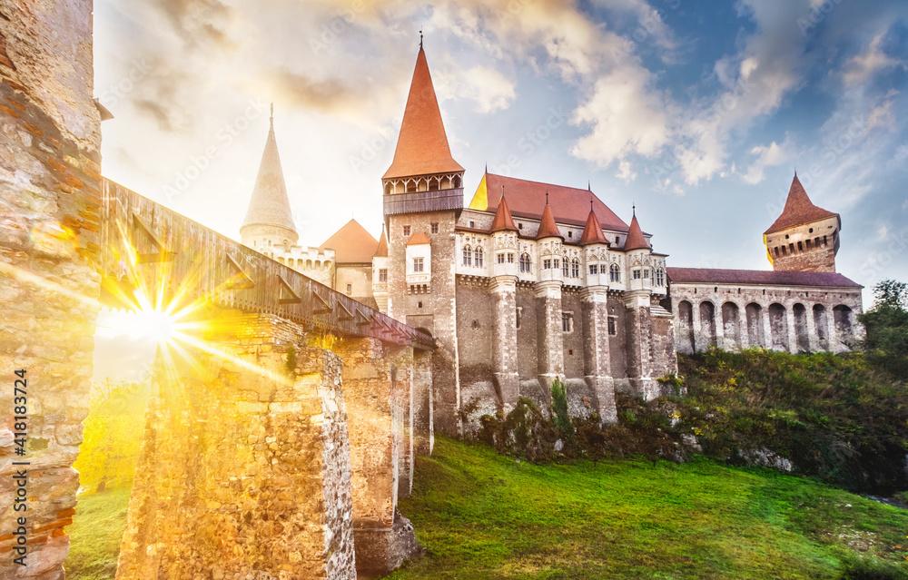 Fototapeta Mysterious hunedoara gothic castle in Romania at dawn