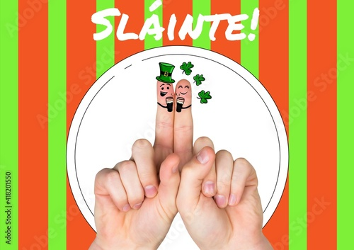 Slainte text with fingers with st patrick's day decorations