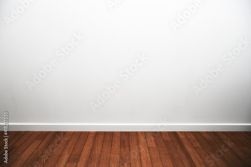 Obraz White room. White room with wood flooring and white trims. - fototapety do salonu