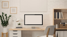 3D Rendering, Home Office Desk With Computer, Supplies, Book Shelf, Plant Pot, Frame, Other Decorations And Chair, 3D Illustration