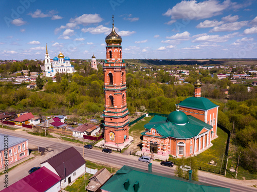 Picturesque rural landscape of small Russian town of Bolkhov with church of Great Martyr George in foreground and Savior Transfiguration Cathedral on background