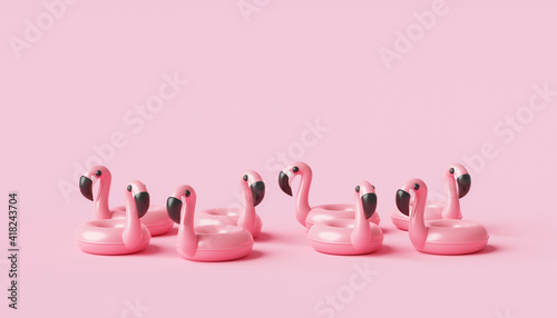Valokuva Minimal flamingo inflatable swimming pool ring and summer season on pink background with tropical holiday concept