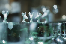 Closeup Of A White Ceramic Deer Spoons Design Hanging On A Glass With Beautiful Soft Bokeh In The Background, Copy Space Festive Image