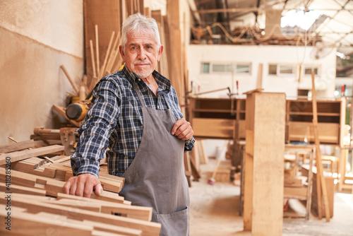 Billede på lærred Senior as a craftsman master and boss