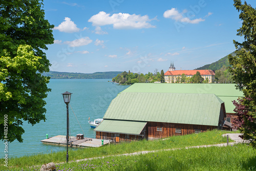 Canvas Tegernsee lakeside with boathouse and view to famous castle, upper bavaria