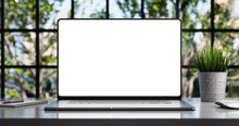 Laptop With Blank Frameless Screen Mockup Template On The Table In Industrial Office Loft Interior - Front View
