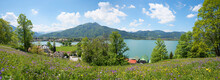 Springtime Panorama, Beautiful Flower Meadow And View To Lake Tegernsee, Leeberg Hill, Bavarian Alps